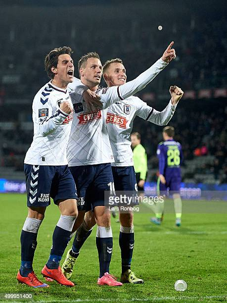 Daniel A Pedersen goalscorer Kim Aabech and Danny Olsen of AGF Aarhus celebrate after scoring their second goal during the Danish Alka Superliga...