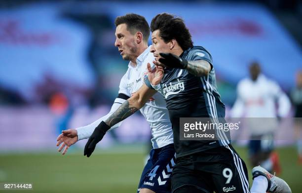 Daniel A Pedersen of AGF Aarhus and Federico Santander of FC Copenhagen compete for the ball during the Danish Alka Superliga match between AGF...