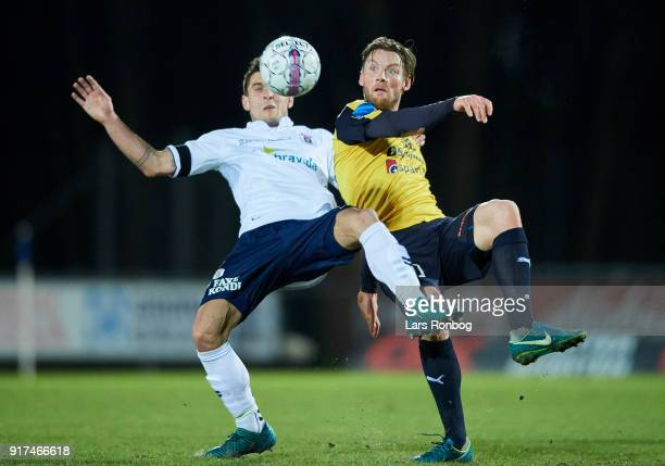 Daniel A Pedersen of AGF Aarhus and Pal Alexander Kirkevold of Hobro IK compete for the ball during the Danish Alka Superliga match between Hobro IK...