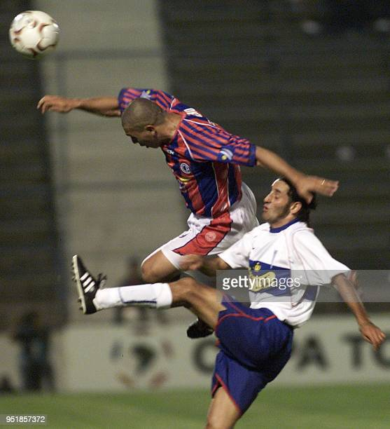 Daniel Achucarro of Cerro Porteno in action against Catholic University's Miguel Ponce during the Copa Libertadores soccer tournament 18 March 2003...