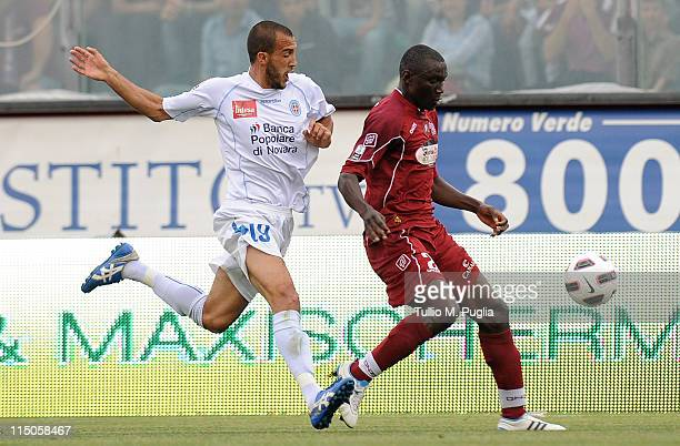 Daniel Adejo of Reggina holds off the challenged by Pablo Andres Gonzalez of Novare during the Serie B playoff match between Reggina Calcio and...