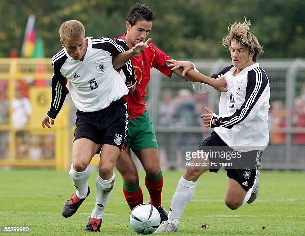 Daniel Adlung and Daniel Halfar of Germany compete with Nuno Coelho of Portugal during the men's under 19 friendly match between Germany and Portugal...