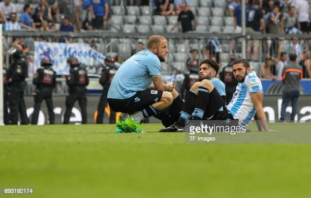 Daniel Adlung of 1860 Munich Sascha Moelders of 1860 Munich looks dejected during the Second Bundesliga Playoff second leg match between TSV 1860...
