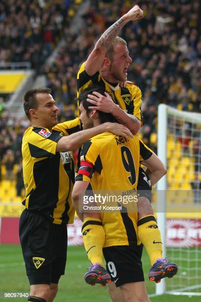 Daniel Adlung of Aachen celebrates the second goal with Szilard Nemeth of Aachen and Benjamin Auer of Aachen during the Second Bundesliga match...
