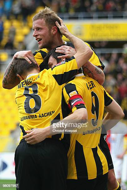 Daniel Adlung of Aachen celebrates the second goal with Szilard Nemeth of Aachen and Benjamin Auer during the Second Bundesliga match between...