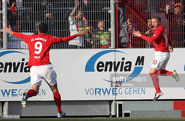 Daniel Adlung of Cottbus and his team mate Emil Jula celebrate the team's second goal during the Second Bundesliga match between FC Energie Cottbus...
