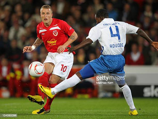 Daniel Adlung of Cottbus battles for the Ball with Godfried Aduobe of Karlsruhe during the Second Bundesliga match between FC Energie Cottbus and...