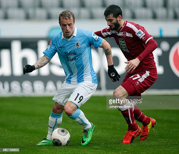 Daniel Adlung of Muenchen challenges Markus Karl of Kaiserslautern during the Second Bundesliga match between TSV 1860 Muenchen and 1 FC...
