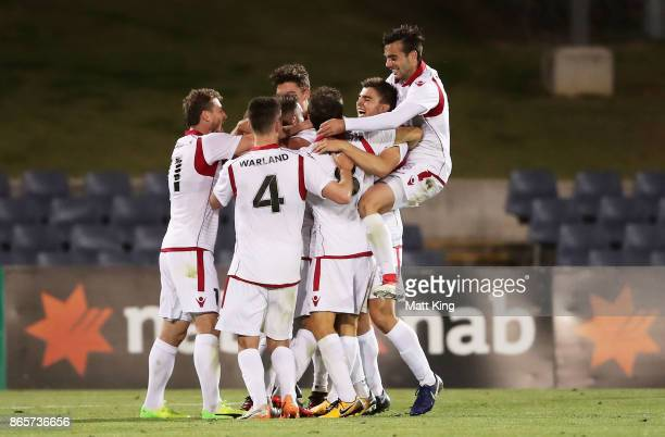 Daniel Adlung of United celebrates with team mates after scoring a goal during the FFA Cup Semi Final match between the Western Sydney Wanderers and...