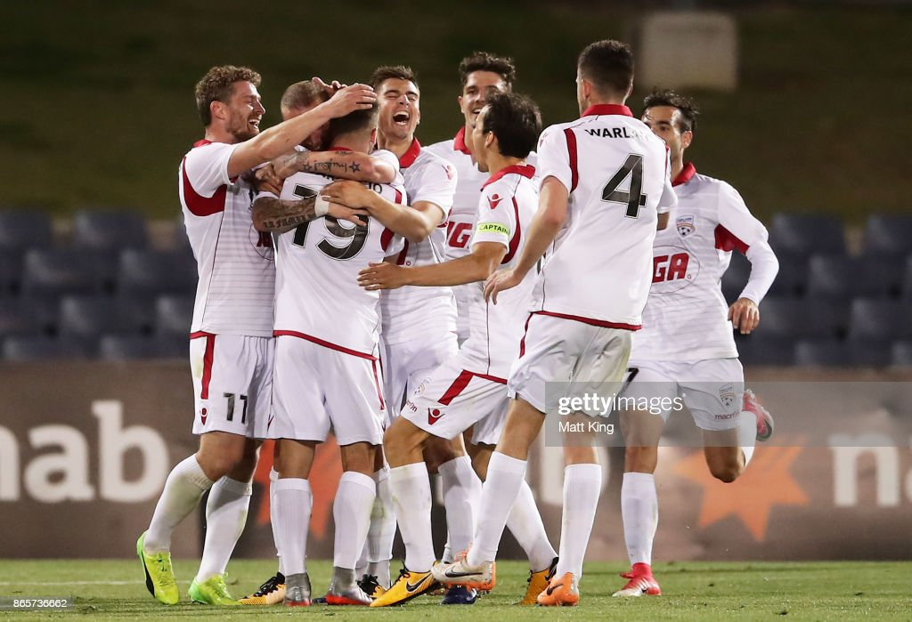 Daniel Adlung of United celebrates with team mates after scoring a goal during the FFA Cup Semi Final match between the Western Sydney Wanderers and Adelaide United at Campbelltown Sports Stadium on October 24, 2017 in Sydney, Australia.