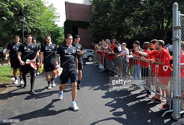 Daniel Agger Danny Ward Jack Robinson Martin Kelly and Conor Coady of Liverpool walks past fans on the entrance before a training session at Harcard...