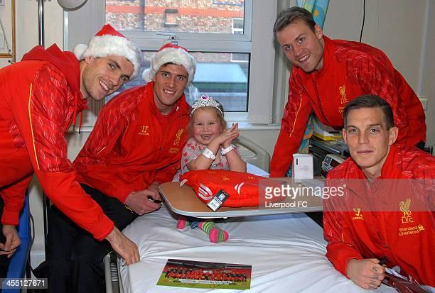 Daniel Agger Jordan Henderson Simon Mignolet and Martin Kelly of Liverpool FC visits patients at Alder Hey Children's Hospital on December 11 2013 in...