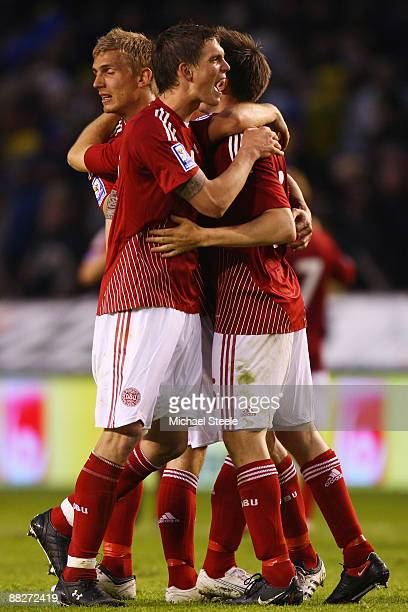 Daniel Agger of Denmark celebrates with team mates after his sides 1-0 victory during the FIFA2010 World Cup Qualifying Group 1 match between Sweden...