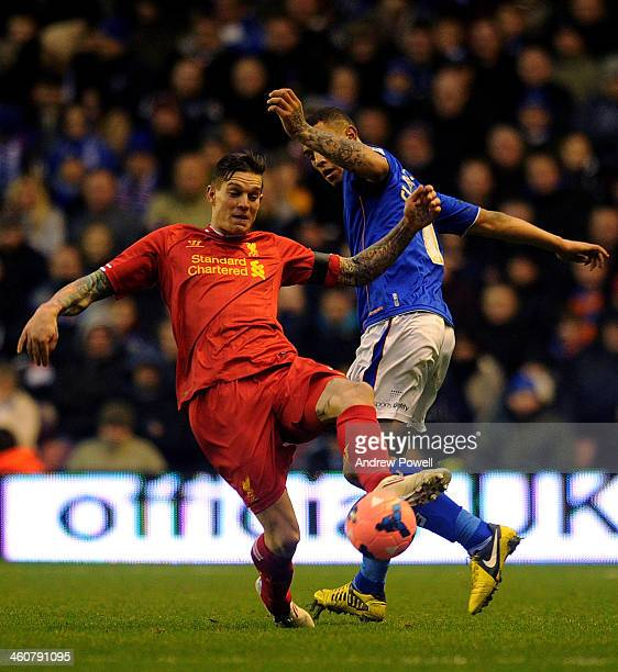Daniel Agger of Liverpool and Jonson ClarkeHarris of Oldham Athletic compete during the Budweiser FA Cup Third Round match between Liverpool and...