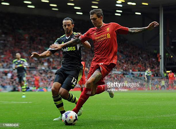Daniel Agger of Liverpool and Marc Wilson of Stoke City compete during the Barclays Premier League match between Liverpool and Stoke City at Anfield...