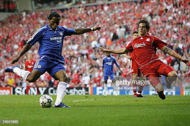 Daniel Agger of Liverpool attepmts to block the shot from Didier Drogba of Chelsea during the UEFA Champions League semi final second leg match...