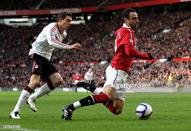 Daniel Agger of Liverpool brings down Dimitar Berbatov of Manchester United to concede a penalty during the FA Cup sponsored by EON 3rd round match...