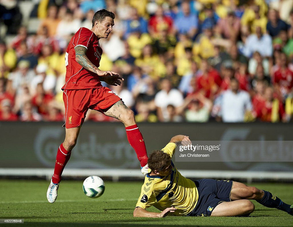 Daniel Agger of Liverpool FC controls the ball during the Pre-Season Friendly match between Brondby IF and Liverpool FC at Brondby stadium on July 16, 2014 in Brondby, Denmark.