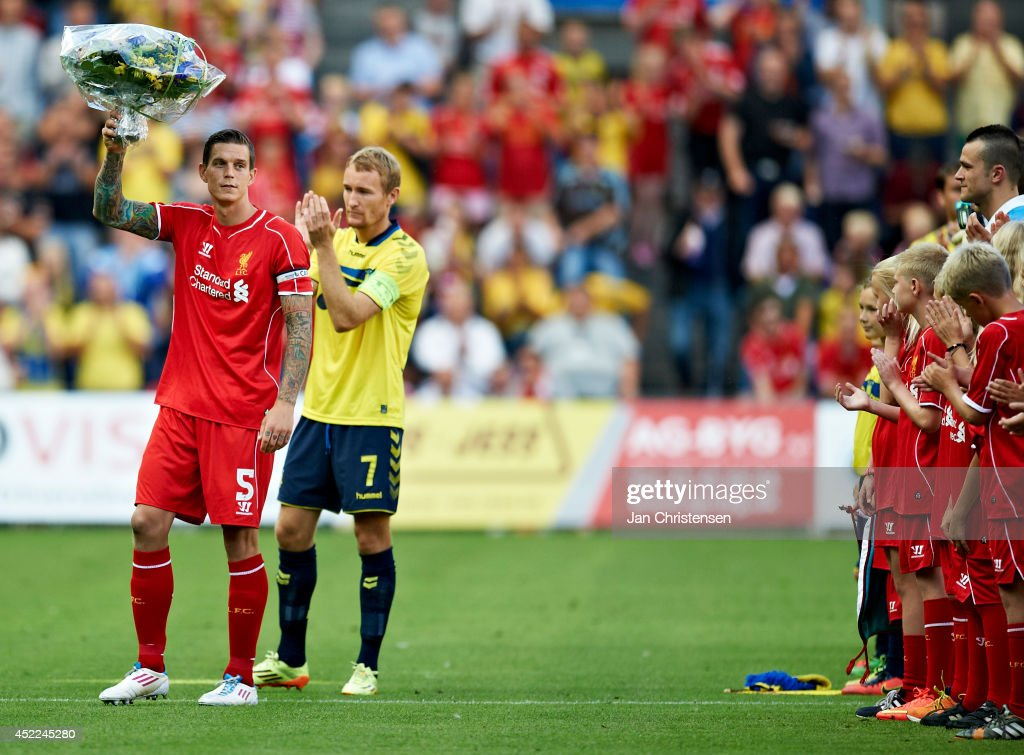 Daniel Agger of Liverpool FC get flowers prior the Pre-Season Friendly match between Brondby IF and Liverpool FC at Brondby stadium on July 16, 2014 in Brondby, Denmark.