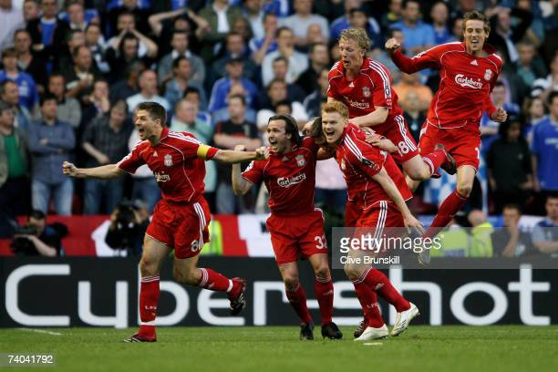 Daniel Agger of Liverpool is mobbed by team mates after scoring the first goal of the game during the UEFA Champions League semi final second leg...