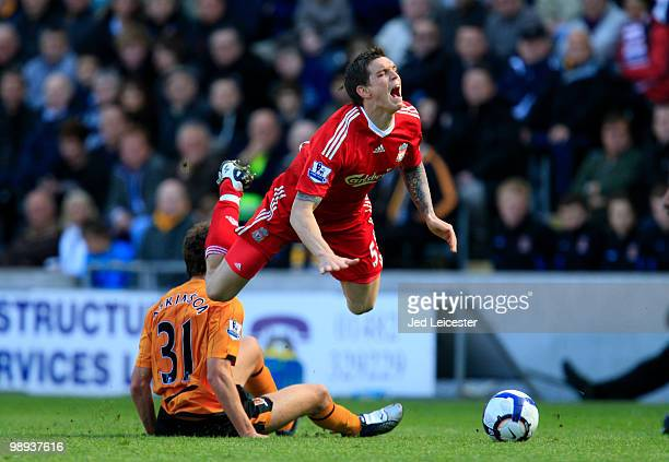 Daniel Agger of Liverpool is tacked by Daniel Atkinson of Hull City during the Barclays Premier League match between Hull City and Liverpool at the...