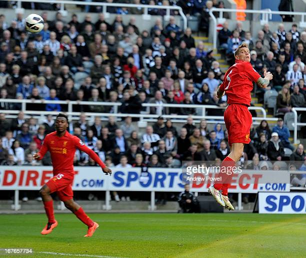 Daniel Agger of Liverpool scores the opening goal during the Barclays Premier League match between Newcastle United and Liverpool at St James' Park...