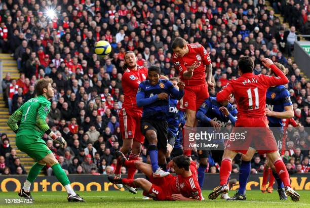Daniel Agger of Liverpool scores the opening goal during the FA Cup Fourth Round match between Liverpool and Manchester United at Anfield on January...