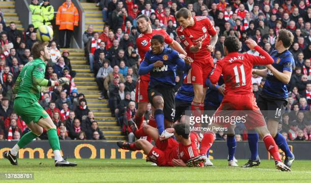 Daniel Agger of Liverpool scores their first goal during the FA Cup Fourth Round match between Liverpool and Manchester United at Anfield on January...