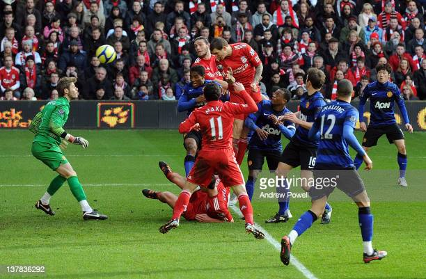 Daniel Agger of Liverpool scores to make it 1-0 during the FA Cup fourth round match between Liverpool and Manchester United at Anfield on January...