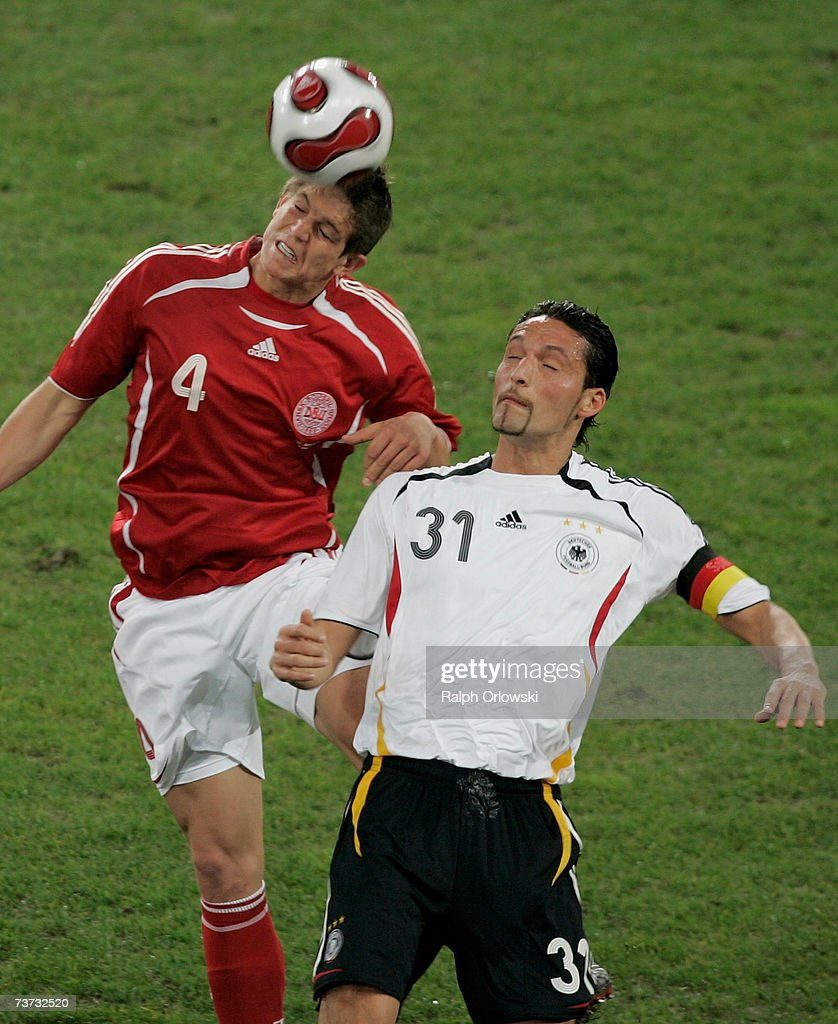 new arrival df356 4e1fe Daniel Agger of the Danish national soccer team and Kevin ...