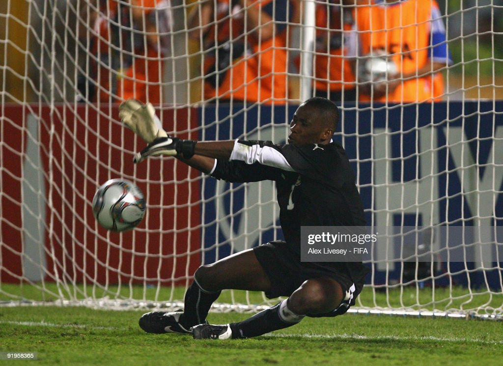 Daniel Agyei of Ghana saves a penalty against Alex Teixeira of Brazil during a penalty shoot out against Brazil in the FIFA U20 World Cup Final between Ghana and Brazil at the Cairo International Stadium on October 16, 2009 in Cairo, Egypt.