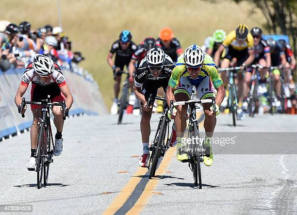 Daniel Alexander Jaramillo Diez of Coumbia riding for Jamis Hagens Berman watches as he is passed on the way to the finish line by Peter Sagan of...