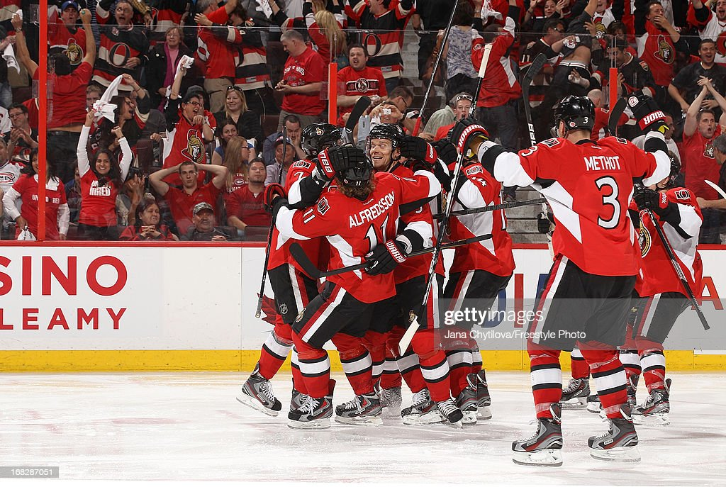 Daniel Alfredsson #11 and Milan Michalek #9 of the Ottawa Senators celebrate their overtime win against the Montreal Canadiens in Game Four of the Eastern Conference Quarterfinals during the 2013 NHL Stanley Cup Playoffs, at Scotiabank Place, on May 7, 2013 in Ottawa, Ontario, Canada.