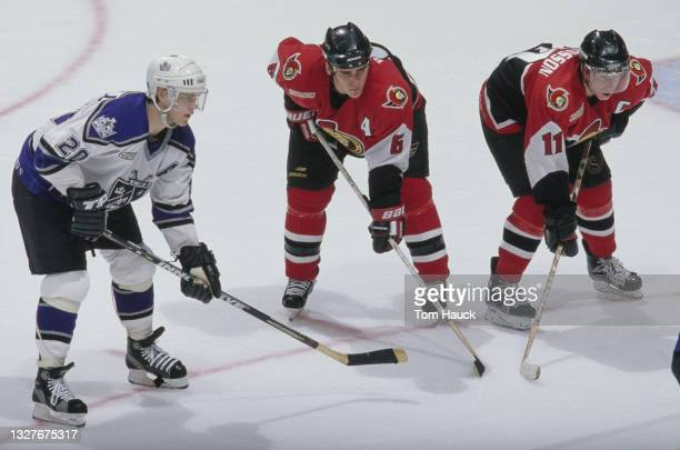 Daniel Alfredsson, Captain and Right Wing and Sami Salo for the Ottawa Senators set for the face off with Luc Robitaille, Left Wing for the Los...