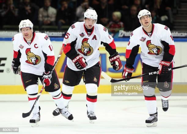 Daniel Alfredsson Dany Heatley and Jason Spezza of the Ottawa Senators celebrate a third period goal against the Frolunda Indians at Scandinavium...