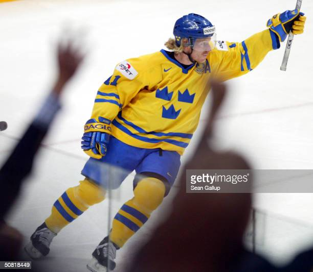 Daniel Alfredsson of Sweden celebrates after scoring against Canada in the teams' match at the International Ice Hockey Federation World Championship...