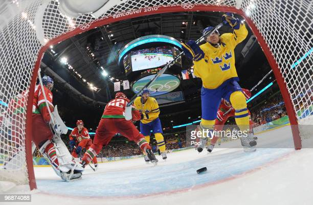 Daniel Alfredsson of Sweden scores a goal against Belarus during the ice hockey men's preliminary game on day 8 of the Vancouver 2010 Winter Olympics...