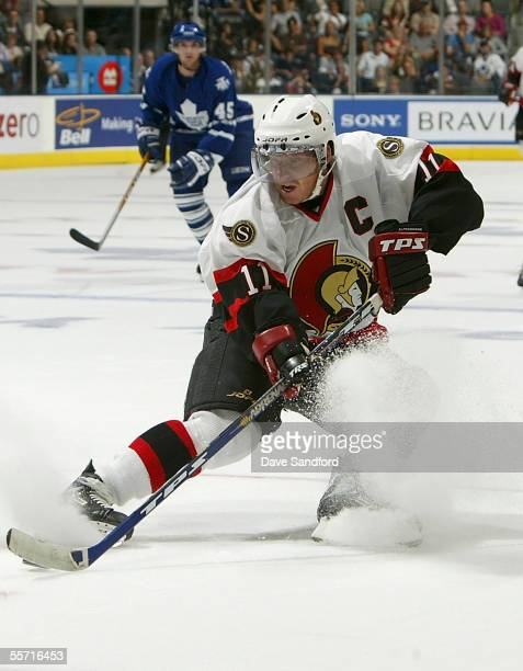 Daniel Alfredsson of the Ottawa Senators carries the puck against the Toronto Maple Leafs during their preseason game at the Air Canada Centre...