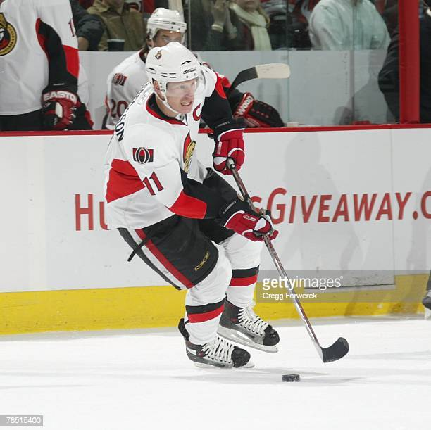 Daniel Alfredsson of the Ottawa Senators carries the puck during their game against the Carolina Hurricanes at RBC Center in Raleigh, North Carolina...