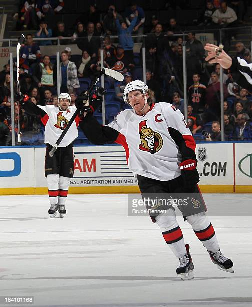 Daniel Alfredsson of the Ottawa Senators celebrates an empty net goal by Guillaume Latendresse at 1951 of the third period against the New York...