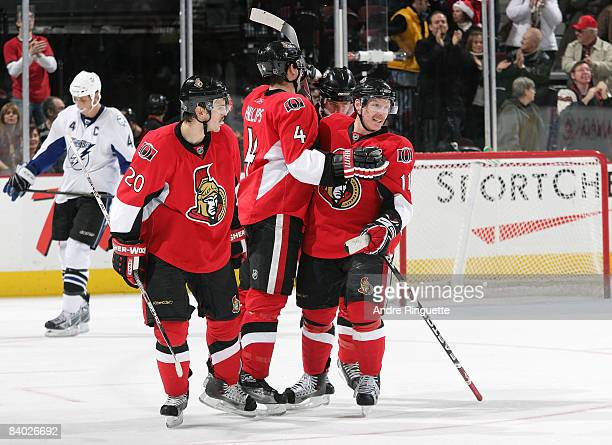 Daniel Alfredsson of the Ottawa Senators celebrates his empty net goal against the Tampa Bay Lightning at Scotiabank Place on December 13 2008 in...