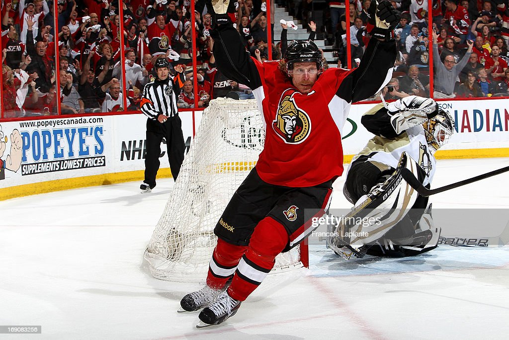 Daniel Alfredsson #11 of the Ottawa Senators celebrates his game tying goal as Tomas Vokoun #92 of the Pittsburgh Penguins reacts in Game Three of the Eastern Conference Semifinals during the 2013 NHL Stanley Cup Playoffs at Scotiabank Place on May 19, 2013 in Ottawa, Ontario, Canada.