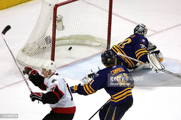 Daniel Alfredsson of the Ottawa Senators celebrates scoring the game-winning goal past Ryan Miller of the Buffalo Sabres during overtime in Game 5 of...