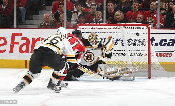 Daniel Alfredsson of the Ottawa Senators outskates David Krejci of the Boston Bruins and scores a short handed goal against Tim Thomas of the Boston...