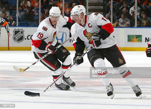 Daniel Alfredsson of the Ottawa Senators plays the puck as teammate Jason Spezza looks on against the New York Islanders on January 29, 2008 at...
