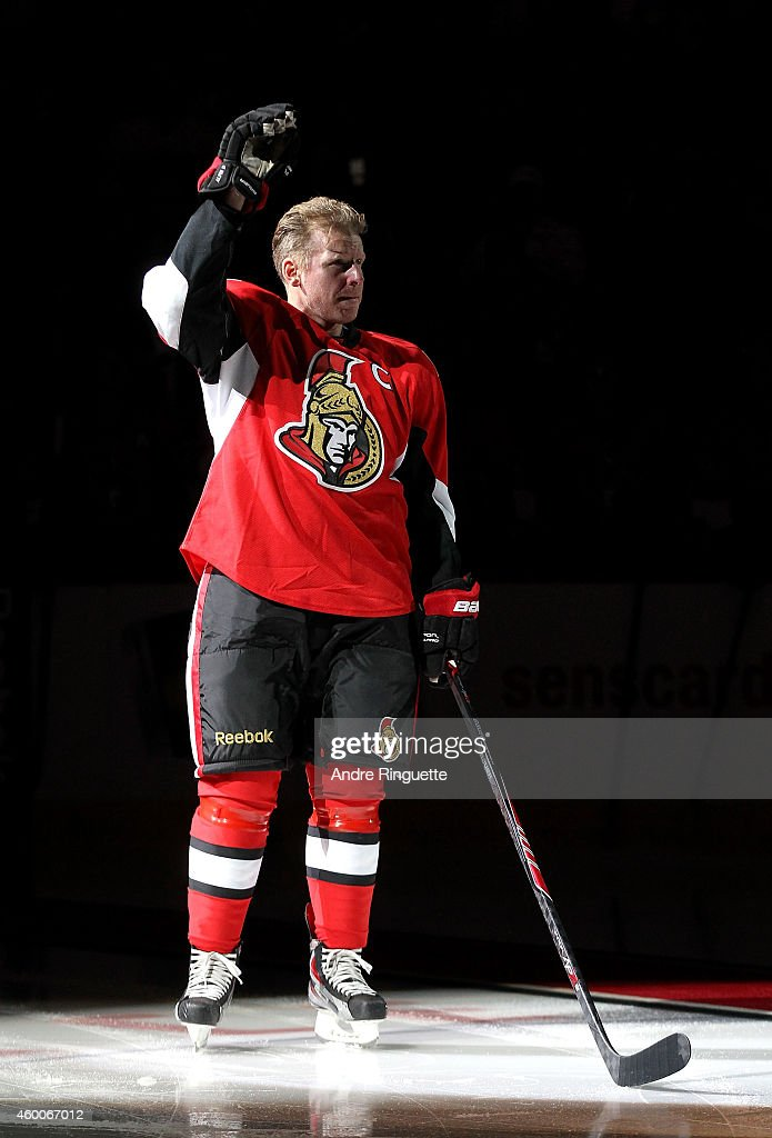 Daniel Alfredsson #11 of the Ottawa Senators salutes the fans during his retirement ceremony prior to a game against the New York Islanders at Canadian Tire Centre on December 4, 2014 in Ottawa, Ontario, Canada.