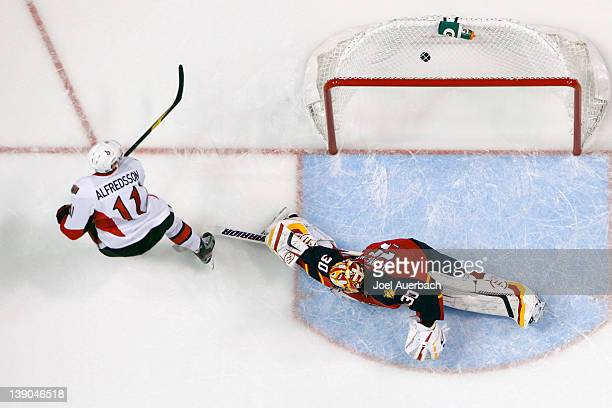 Daniel Alfredsson of the Ottawa Senators scores a goal past goaltender Scott Clemmensen of the Florida Panthers on February 15 2012 at the...