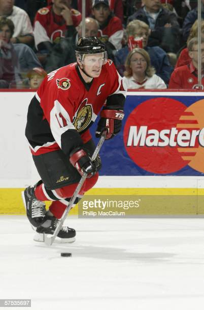 Daniel Alfredsson of the Ottawa Senators skates with the puck during game 2 of the Eastern Conference Quarter Finals against the Tampa Bay Lightning...