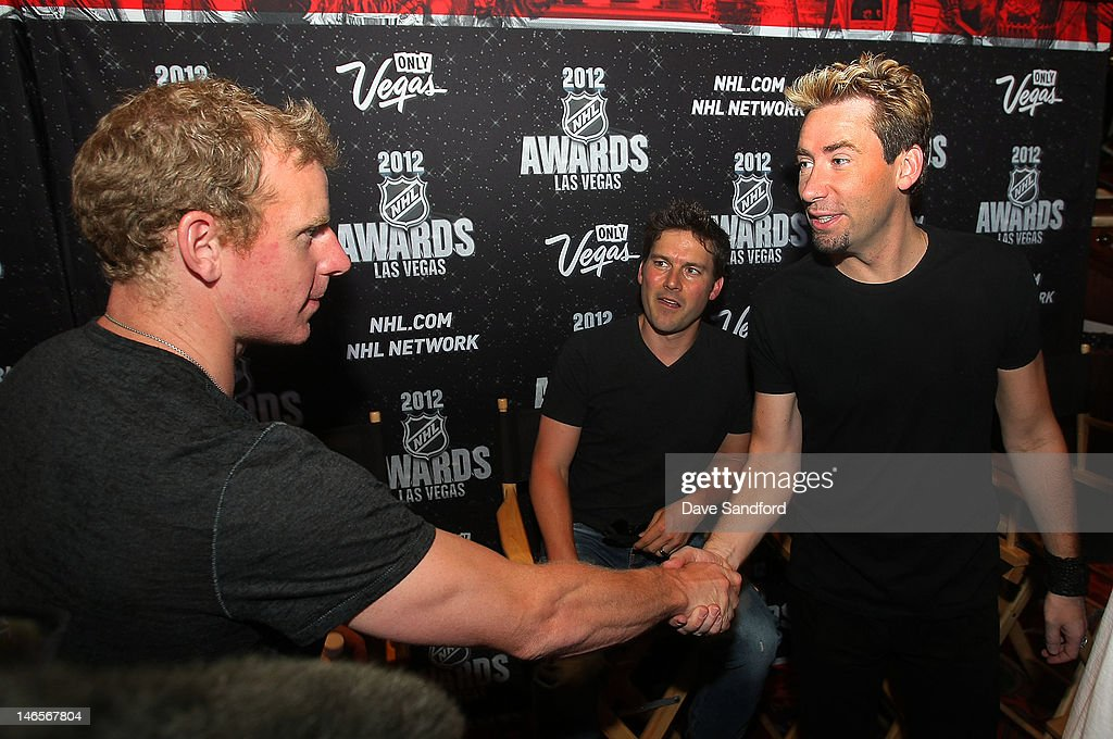 Daniel Alfredsson of the Ottawa Senators speaks with Chad Kroeger (right) and Ryan Peake both of the band Nickelback during the 2012 NHL Awards Nominee Media Availability at the Wynn Las Vegas Resort on June 19, 2012 in Las Vegas, Nevada.
