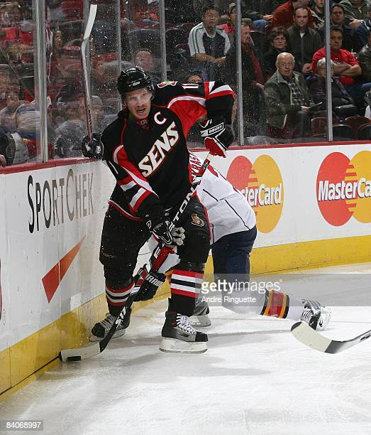 Daniel Alfredsson of the Ottawa Senators stickhandles the puck against the Florida Panthers at Scotiabank Place on December 8 2008 in Ottawa Ontario...